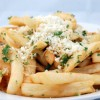 Fries Drizzled with Fresh Garlic Feta and Parmesan Cheese
